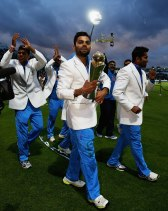 Virat Kolhi during the victory lap of Champions Trophy 2013 final.