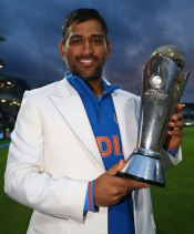 Mahender Singh Dhoni with the Champions Trophy 2013